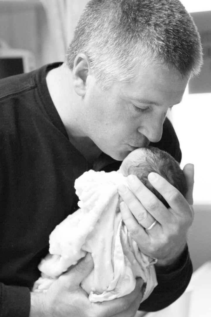 The first time I sat in Mitch's office, I couldn't even say Gideon's name.  It hurt too much.  I couldn't imagine what was to come and everything felt like it was spinning out of control.  Months later Mitch stood as a pillar of strength for our family.        This was a precious moment, as Pastor Mitch got to give kisses to the very baby he watched change our lives forever.  Mitch is a big reason why Gideon's name is so precious, sweet and easy for me to say today.