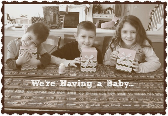 "They each opened up their little ""early Christmas present"" that was a cupcake announcing we were having a baby."
