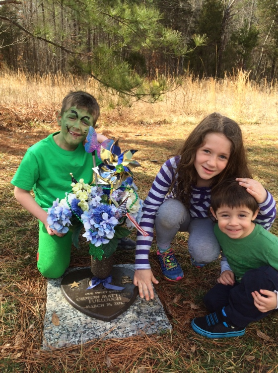 """Aaron, my youngest, skipped through the cemetery saying """"Yay this is where we let go all those balloons!""""  Never did I ever imagine that a graveyard could be a joyfitul place to go, but for us it is.  I mostly love the pinwheel that sits in Gideons marker.  Is"""