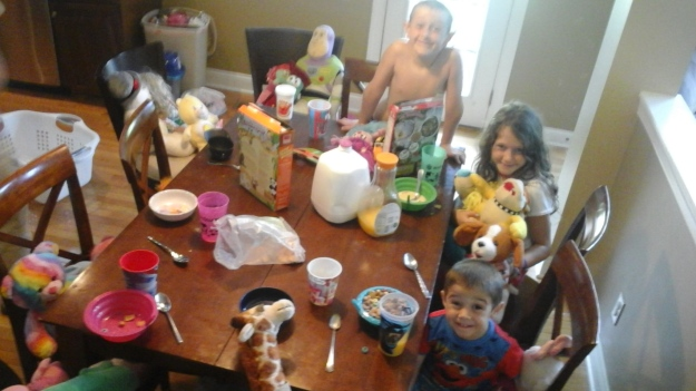 We've had stuffed animal breakfast parties, video game marathons, card game battles, traffic town (Daddy set literally set up traffic patterns to follow inside on their scooters), pool visits, you name it this family is doing it together...and its awesome.